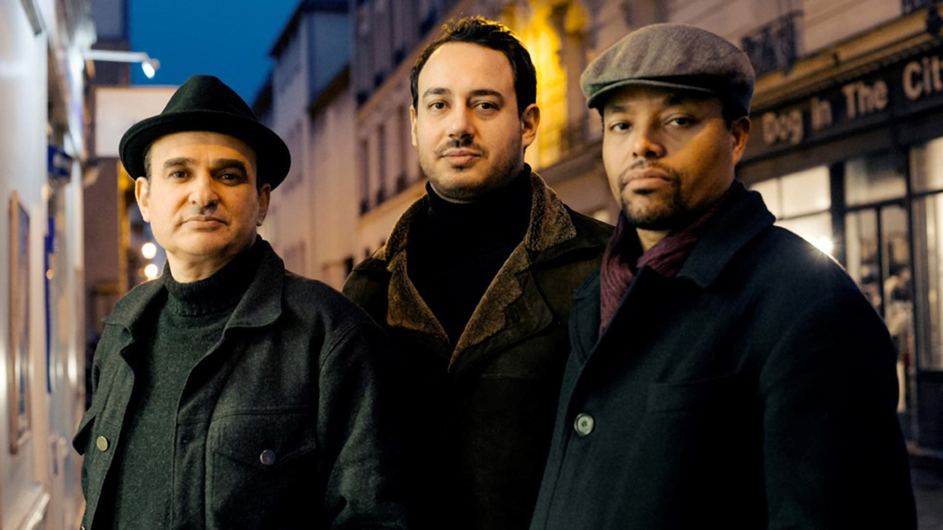 Yacine Boulares (center), Vincent Segal (left), Nasheet Waits (right)