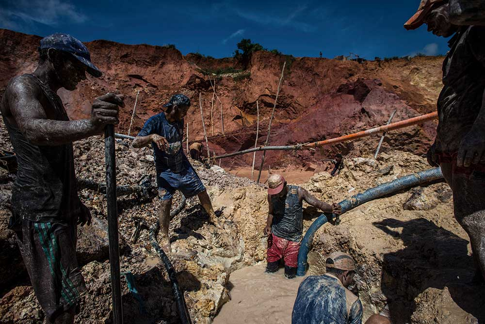 "Crew at the illegal ""Cuatro Muertos"" gold mine in Venezuela, 2016."